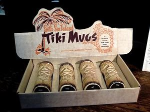 Paul Marshall Products tiki mugs in their original packaging in the Tiki Pop exhibit at Mus�e du Quai Branly in Paris
