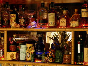 Rum and mugs behind the bar at Tiki Taky in Praha