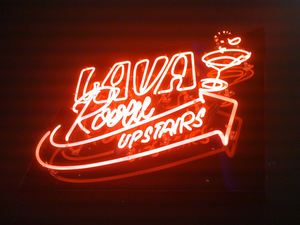 Neon sign pointing to the upstairs Lava Room lounge at Trader Vic's in Las Vegas