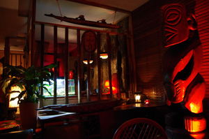 Tiki overlooking seating area at Tiki Lounge and Bar in Richmond