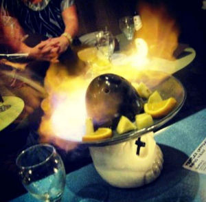 Serving vessel en flambe at Trailer Happiness in London