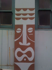 Tiki painted on the outside of Aqua Surf Shop in San Francisco