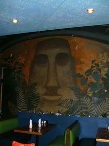 Moai mural on back corner wall at Luau Hale in Lenox