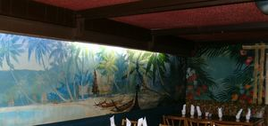 Small room with murals at Luau Hale in Lenox