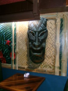 Trompe-l'oeil tiki mural across from the bar at Luau Hale in Lenox