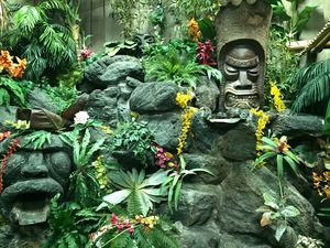 Waterfall and tikis in The Hidden Village at Don the Beachcomber in Huntington Beach