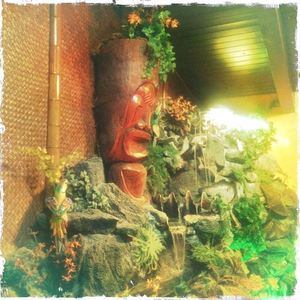 Tiki and water feature at Don the Beachcomber in Huntington Beach