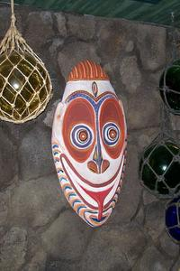 Tiki mask in gift shop at Tiki's Grill & Bar in Honolulu