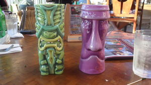 Souvenir tiki mugs at Tiki's Grill & Bar in Honolulu