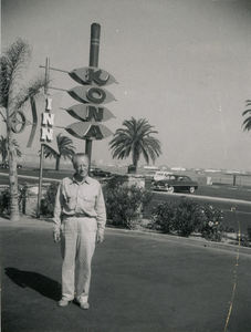Polaroid photo of a gentleman standing in front of the sign for Kona Inn in San Diego