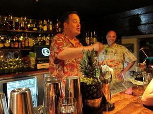 Bartender Marcovaldo Dionysos and manager Alex Smith behind the lower bar at Smuggler's Cove in San Francisco