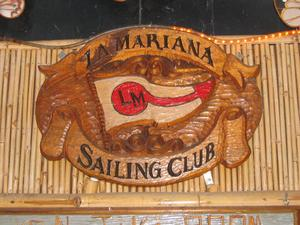 Carved sign over entry at La Mariana Sailing Club in Honolulu
