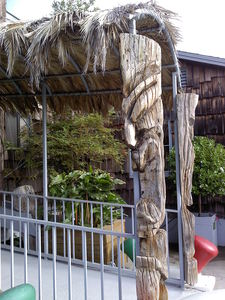Entrance tikis (one tiki that has been split down the middle) at The Waterfront Restaurant in Redwood City