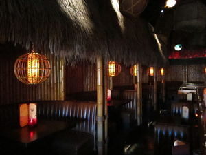 Interior huts along the wall at Tiki No in North Hollywood