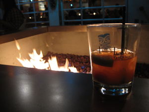 Logo glassware and outdoor firepit at Hula's Modern Tiki in Phoenix