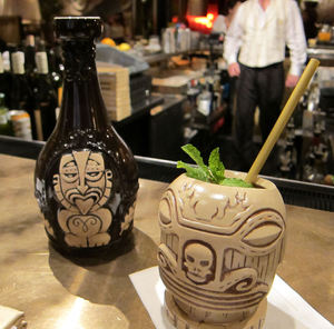 Tiki mug and bottle at The Hurricane Club in New York