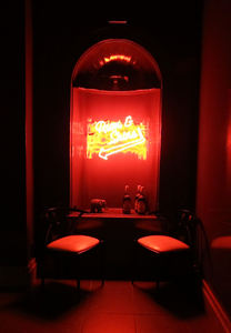 Neon sign pointing to the Rum and Shine station at The Hurricane Club in New York