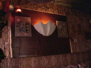 Clamshell sconce and wall decor at Okolemaluna Tiki Lounge in Kailua-Kona