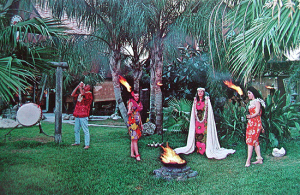 Postcard showing the torch lighting ceremony at Tiki Gardens