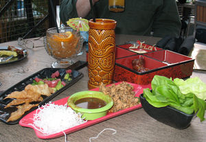 HippopotoMai-Tai, Krakatoa Punch, Pu Pu Platter, Chicken-Lettuce Wraps, Ahi Poke (clockwise from top) at Trader Sam's Enchanted Tiki Bar in Anaheim