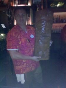 Bartender holding a tiki by Patrick Sousa at Trader Sam's Enchanted Tiki Bar in Anaheim