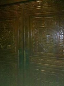 Front doors carved by Leroy Schmaltz of Oceanic Arts, at Trader Sam's Enchanted Tiki Bar in Anaheim