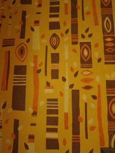 Wallpaper in the bathroom from a design by Mary Blair at Trader Sam's Enchanted Tiki Bar in Anaheim