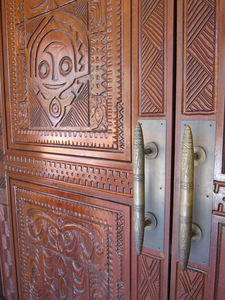 Door, carved by Leroy Schmaltz of Oceanic Arts, and door pulls at Trader Sam's Enchanted Tiki Bar in Anaheim