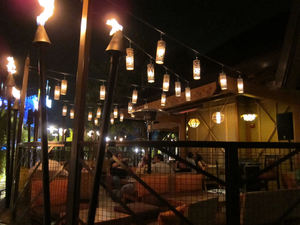 Outdoor patio at night at Trader Sam's Enchanted Tiki Bar in Anaheim