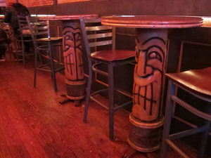 Carved tiki tables at Tiki Haven in San Francisco