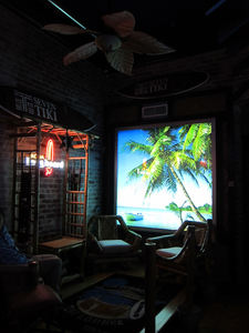A back-lit beach scene at The Downtown Tiki Lounge in San Mateo