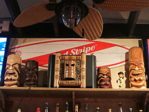 A few small carved tourist tikis at The Downtown Tiki Lounge in San Mateo
