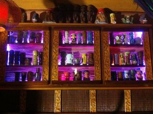 Tiki mugs on display at Aku Aku Tiki Bar in Oslo