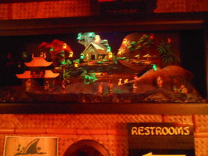 "Lighted Chinese diorama decorated with ""drink monkeys"" at The Breakers in Crystal Lake"