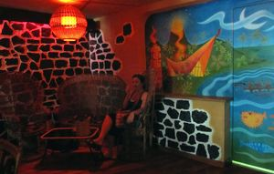 Back corner seating at Le Tiki Lounge in Paris