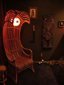 Rattan wave chair and Basement Kahuna carving at Balhi Ha'i in San Francisco