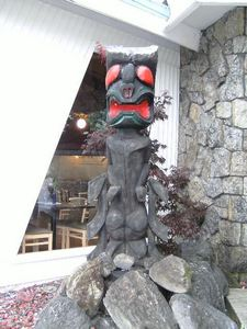 Tiki to the left of the entrance to The Tiki in Lake George
