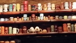 Tiki mug collection at Porco Lounge & Tiki Room in Cleveland