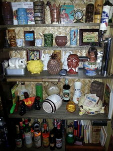 Some of the tiki mugs and bowls on display at 65th Street Revival in Oakland