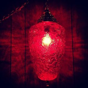 Red swag lamp at The Sandy Bottom in Portland