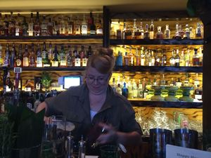 Suzanne Long behind the bar at Longitude in Oakland