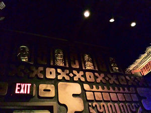 "Upper section of ""Temple of Doom"" wall with golden idols at The Tiki Hideaway in Charlotte"