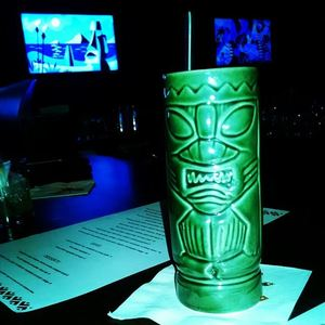 Drink in a tiki mug at The Tiki Hideaway in Charlotte