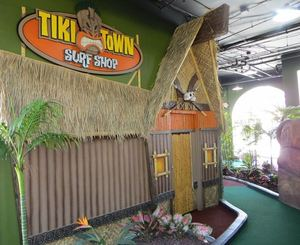 "Faux ""surf shop"" facade at Tiki Town Adventure Golf in San Diego"