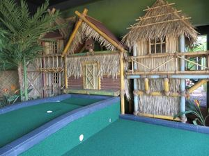 A village overlooks one of the holes at Tiki Town Adventure Golf in San Diego