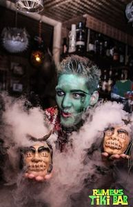Promotional photo for a Halloween event at Rumpus Tiki Bar in Budapest
