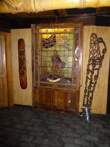 Stained glass mural and carvings in the bar at Trader Vic's in London