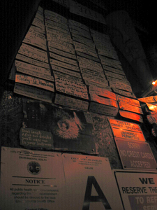 Names of regulars are posted on the wall, with other signs at Tiki-Ti